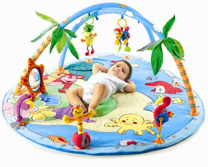 Развивающий коврик для ребенка новорожденного