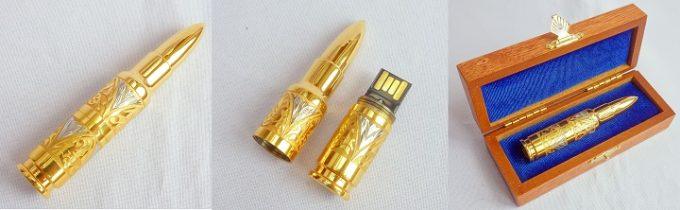 золотая флешка в виде пули в коробке