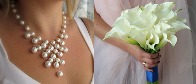 Букет белых кал и жемчужнео ожерелье